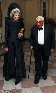 Former Secretary of State Henry Kissinger arrived with his wife Nancy