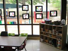 Preschool art space.  I love the bottles on the window!