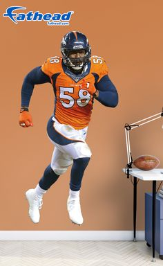 Von Miller, Denver Broncos | Fathead wall decals are life-size action images that you stick on any smooth surface. You can move them and reuse them and they are safe for walls. Fathead wall decals are way better, bigger and tougher than a poster or sticker. SHOP www.fathead.com | Home Decor | Kids DIY Bedroom | Custom Decals | Wall Murals | Peel & Stick | Man Cave