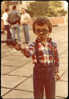 Benny Blanco From The Bronx. oh wow. As much as I love this movie. why is this lil kid holding a gun?