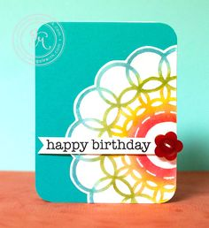 @Jennifer McGuire used a fun mask, some white heat embossing, Distress Markers and a pearlized water mist to make this colorful birthday card