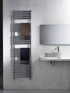 Multiple electric radiators from the Design collection will accommodate your need for a radiator body that can also furnish and decorate its surroundings, or why not pick a heated towel rail if you need a designer radiator for your bathroom. Electric Radiators, Designer Radiator, Towel Warmer, Heated Towel Rail, Interior Decorating, Shelves, Steel, Bathroom, Wall