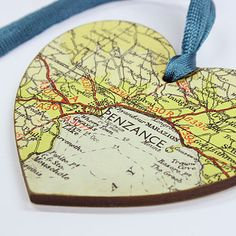 Map ornaments from family vacations - put the dates on the back.