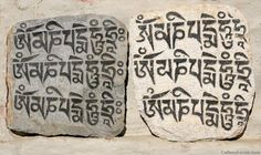 The mantra 'Om Mani Padme Hum' on prayer stones. The prayer invokes the blessings of the essence of Chenrezig, the Buddha who embodies compassion.