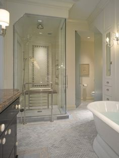 Herringbone Tile for Master bathroom. Little contemporary touch with the glass panels but still traditional style which I like