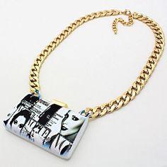 """• Style No : 241820 %0D%0A• Color : Gold / Black / Blue / White %0D%0A• Necklace Size : 20"""" + 3"""" L %0D%0A• Charm Size : 3"""" X 2"""" %0D%0A• Ceramic-Like Heavy Clutch Charm / Resin Enamel / Vogue Magazine %0D%0A• Magazine Clutch Charm Necklace %0D%0A• Material : Lead, nickel, cadmium compliant"""
