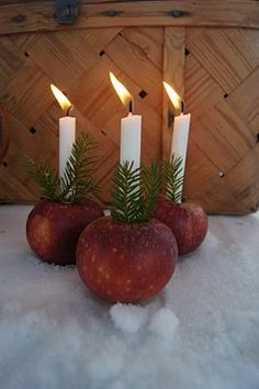 A cored apple makes for a sweet candle holder.