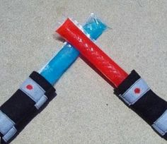 light saber popsicles (Otter Pops in a simple felt holder)---- the boys would totally dig that!