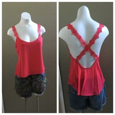 """Pink tank top Pink tank top with floral accent straps that cross in the back. 100% polyester and 24"""" in length. Tops Tank Tops"""