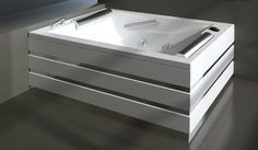 Treesse's stylish large bathtub with silver lines and cushions / Bis Line Collection