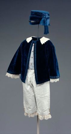 1855 Boy's jacket with white collar, white short trousers.