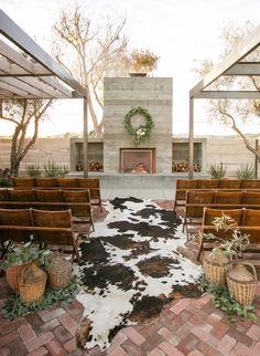 With a faux cow skin rug as an aisle centerpiece, wicker basket ceremony markers, and fireplace altar, this ranch style wedding is cozy and inviting, perfecting Southwestern charm. Wedding Isle Decorations, Altar Decorations, Wedding Isles, Rustic Wedding Venues, Southwestern Wedding Decor, Western Centerpieces, Perfect Wedding, Dream Wedding, Cow Skin