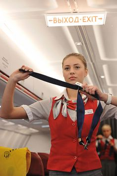 Red Wings Airlines: if all else fails, you'll be tied up with seatbelt straps! Tie Up Stories, Dramatic Play Themes, Airline Reservations, Airline Uniforms, Flight Attendant Life, Intelligent Women, Fear Of Flying, Military Women, Girls Uniforms