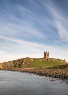 Landscape image of Dunstanburgh Castle on Northumberland coastli by Matt Gibson / 500px