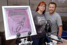 Privation Printing owners Shelley and Tim Larsen stand with a shirt design at Autry Technology Center's James W. Strate Center for Business Development. (Staff Photo by BILLY HEFTON)