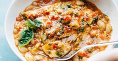Garlic Basil Barramundi Skillet! with basic ingredients like garlic, basil, tomatoes, white beans, and Parm. Perfect with a green salad and crusty bread.