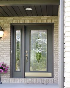 Steel Entry door with one sidelite and full decorative glass.