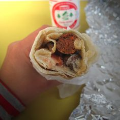 Sausage sandwich from Abu Elias in #Montreal © Will Travel for Food