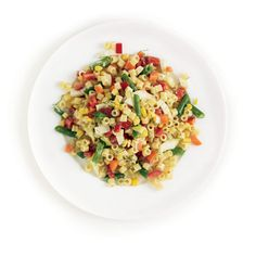 Creamy Pasta Salad Recipe with carrot, green beans, corn, fennel, red pepper, parsley and light ranch dressing.