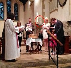 Familiar face:  A grandmother was left astonished after a photo posted on Facebook from her granddaughter's christening appeared to show the ghost of her late husband.  The bizarre image was caught on camera at St Martin's Church, Canterbury, Kent by Mrs Sewell's son Jamie, 29, on his mobile phone. It was only when the grandmother-of-two was looking through the photos online later that she spotted the familiar face beside the family.