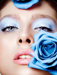 A beautiful sequence of makeup looks in various colors and adorned with roses created by makeup artist Hara Papanikolaou.