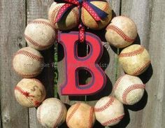 Are you a baseball family? Show your team pride with your Baseball Love Wreath. Made with 11 used baseballs (for that well-worn, vintage-y feel), wreath can be personalized to any team you wish! Youth..