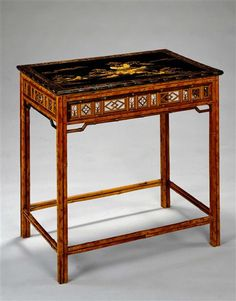A CHINESE BAMBOO AND LACQUER TABLE