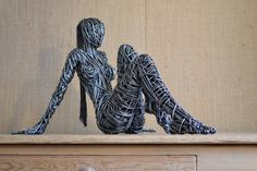 Stainthorp, a professional sculptor, began making wire sculptures in 1996.  Now, his body of work features incredible human nudes, angels and trees — all created by manipulating two dimensional lines.  Stainthorp explains that since his medium is a difficult one to work with, the reward of merely having completed a structure is satisfying.