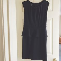 Spence Black Peplum Dress Black dress with peplum and buttons up the back. Someone gave it to me, but it was too big on me. Spense Dresses Mini