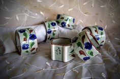 """Footed floral napkin rings Six pottery / ceramic napkin rings Mexican pottery Blue floral on pale green 1.25"""" wide surface Marked Mex 747 by STUFFEZES on Etsy"""