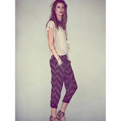 Free people harem pants Harem pants; chevron pattern brown with shades of pink/coral. Zip bottoms Free People Pants