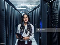 Stock Photo : Mixed race technician holding digital tablet in server room