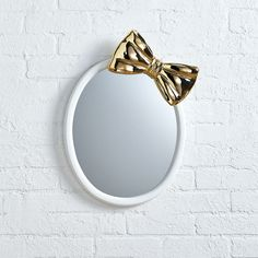 Shop Bow Mirror. Our exclusive Bow Mirror, designed by Brienna Wagner features a giant gold bow on top of an oval mirror for a unique touch to your girls' bedroom.