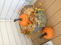 I made this for $10.00 Old steel bucket, small bale of hay, fall themed floral fillers from Michael's with pumpkins and cute trick or treat sign. It looks so cute by the front door. I may even leave it out and change it for Christmas.