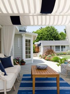 Pergola + Draperies in 20 Ways to Beautifully Shade Your Outdoor Room from HGTV