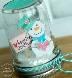 Mason Jar Snow Globe - this would be adorable for all sorts of holidays and themes. From Betsy Veldman.