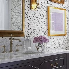 Black Sink Vanity with Brass Pulls and Gold Metal Beveled Mirror Thibault Tanzania Wallpaper