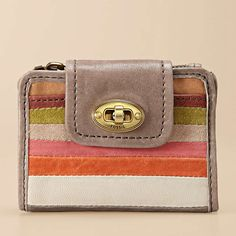 A soft leather wallet that is multifunctional, but will fit in about anywhere and is still a fun rainbow-is there money at the end of this rainbow wallet? That depends on the day you catch me.