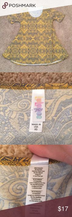 NWOT LuLaRoe Perfect Tee 💖New without tags! Super cute print!                                           💖Price is firm! But B1G1 FREE anything in my closet!                 💖Bundle for the best offer! LuLaRoe Tops Blouses