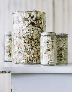 white buttons in glass containers