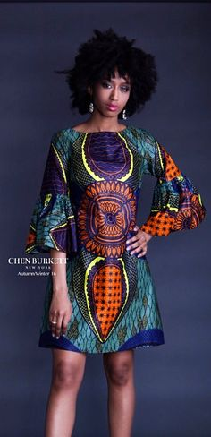 All New! The Yuma Dress. The Yuma, beautifully detailed dress and impeccably tailored for a timeless and flattering look from soft Vlisco Java. Gathered and flounced cuffs add a romantic retro vibe with a comfortable neckline and leggy hemline. African print | Nigerian Fashion | African Fashion | African print dresses | African dresses | Dashiki Dress | African clothing | Dashiki skirt | African dress styles | African dress | African attire (affiliate)