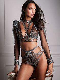 Victoria's Secret Designer Collection lace top with pavé Swarovski crystal buttons; modeled by Angel Lais Ribeiro. Timeless glamour and couture details only Victoria's Secret could create. Available at select Victoria's Secret stores worldwide. swarovs.ki/VSdesigner