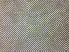 Fabric for living room chair. A muted green in a woven fabric. From any distance, the pattern looks more subtle and more like a texture.