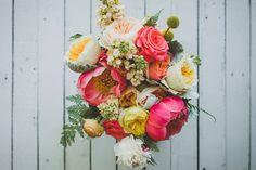 spring bouquet with coral charm peonies, photo by Jason Hales Photography http://ruffledblog.com/fernbank-museum-wedding #peony #weddingbouquet #flowers
