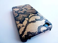 lace cell phone case-   1.A small piece of lace fabric    2. Spray paint in black and gold from the Home Depot.   3. Painter's tape   4. A cell phone case    5. A piece of foam core-buy some at any art or craft store.   6.  Old newspaper