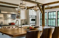 White kitchen accentuated with exposed wooden beams - Crisp Architects