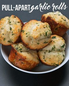 Ingredients:   1 tube refrigerated biscuits  3 Tbsp. butter, melted  1/2 tsp garlic powder  2 Tb...
