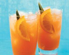 1 1/2 oz Malibu Passion Fruit Rum  1 oz Polar Ice Vodka  5 oz pineapple juice 1 tsp grenadine maraschino cherry orange slice