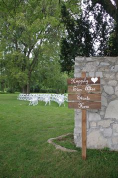 Adorable rustic sign at ceremony space for charming August 2017 wedding