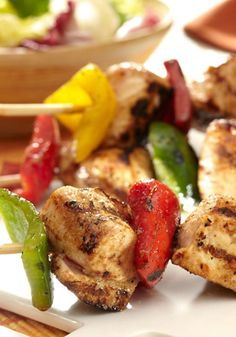 Grilled Rainbow Chicken Kabobs -- In this healthy living recipe, a trio of colorful peppers are threaded with chicken pieces on skewers. Then, the kabobs are marinated and basted with KRAFT Lite House Italian Dressing.